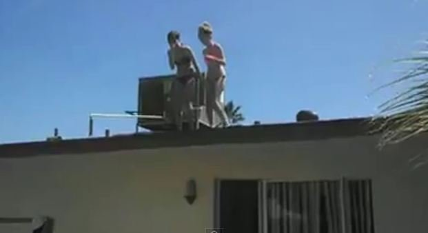 Nicole and her friend prepare to jump off the roof into her pool.