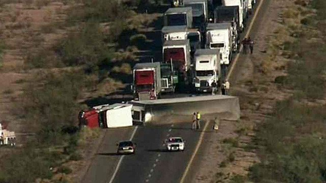 Eastbound traffic was stopped after this rig rolled on Interstate 10 at Tonopah. (Source: CBS 5 News)