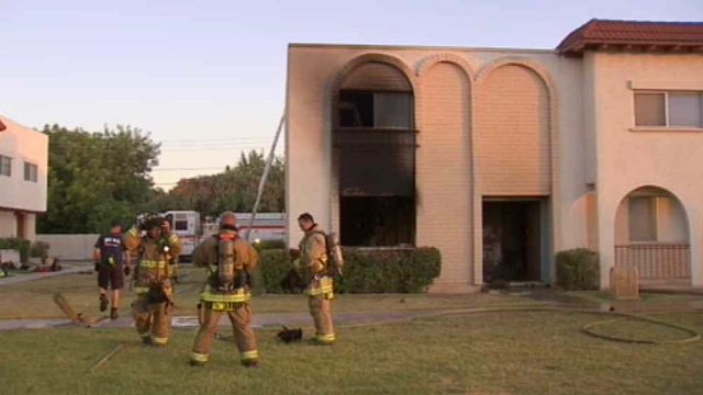 A man suffered second- and third-degree burns and is being treated at Maricopa County Medical Center in Phoenix after a fire in his Mesa townhome Sunday. (Source: CBS 5 News)
