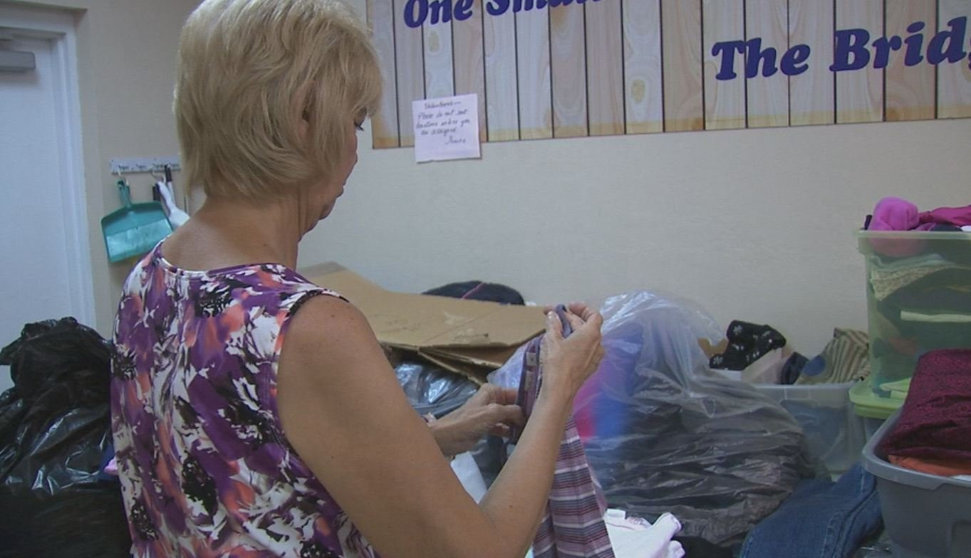 A volunteer sorts donations that come into The Clothes Cabin.