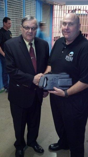 Buck Dikes picking up Sheriff Arpaio's sling he bought on eBay. (Source: CBS 5 News)