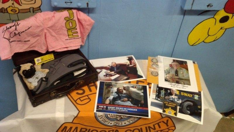 The offering also included several autographed photos of Arpaio in various poses wearing the sling. (Source: CBS 5 News)