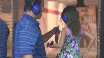 National Take Your Daughter to the Range Day at Shooter's World in the Valley. (Source: CBS 5 News)