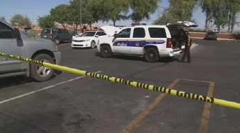 Shooting scene in parking lot of a Valley Home Depot. (Source: CBS 5 News)