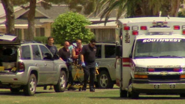 A home invasion suspect is wheeled to a waiting ambulance after he was captured in Sun City on Friday morning. (Source: CBS 5 News)