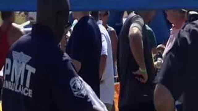 Paramedics tend to several runners who fell ill from the heat. (Source: CBS 5 News)