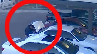Surveillance image of suspect breaking into a car. (Source: Silent Witness)