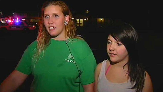 Caitlin Bildilli, left, and Allana Gallup took the two children to a nearby park while firefighters fought the fire. (Source: CBS 5 News)