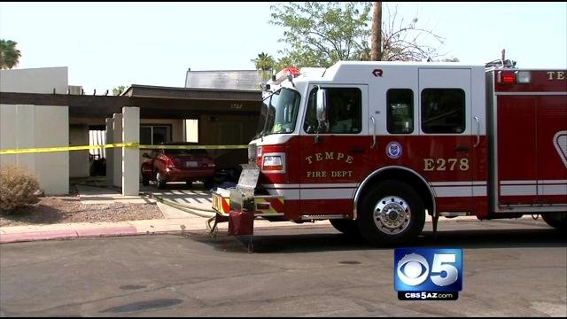 Woman burned and in critical condition in wake of Tempe house fire. (Source: CBS 5 News)