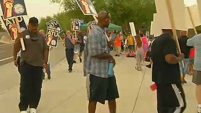 Picketers gathered at Rio Salado Parkway and Priest Drive in Tempe on Thursday morning after bus drivers with Amalgamated Transit Union Local 1433 went on strike at midnight. (Source: CBS 5 News)