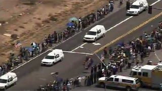 People gather alongside a rural highway to pay their respectsSunday . (Source: CBS 5 News)