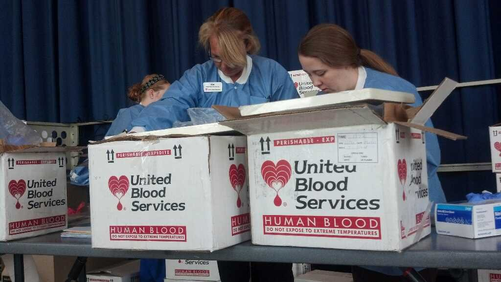 United Blood Services staff package up donations (Source: Christina Batson, CBS 5 News)