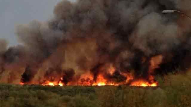 The fire is burning through at least 300 acres. (Source: Billy Schneider)