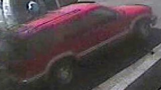 The getaway  vehicle is described as a 2000 GMC four-door Jimmy. (Source: FBI)