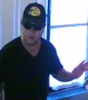 The man is believed to have robbed the AG Massage Parlor three times since December. (Source: Silent Witness)