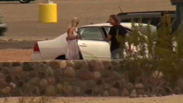 James Arthur Ray, with long hair and wearing a dark shirt, is shown getting ready to leave the Lewis prison complex in Buckeye on Friday morning. The woman on the left is not identified. (Source: CBS 5 News)