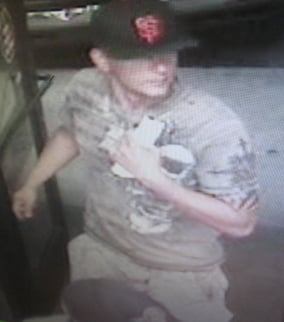 The suspect was caught on a surveillance camera as he left the store.  (Source: Phoenix Police Department)