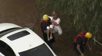 Woman trapped by flood waters rescued at 83rd St. and Desert Cove in Scottsdale. (Source: CBS 5 News)