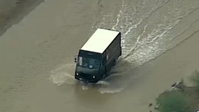 Heavy rain triggered street flooding. (Source: CBS 5 News)