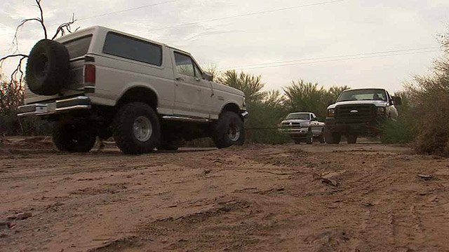 The Ford Bronco on the left was swept away by floodwaters Sunday near Apache Junction. (Source: CBS 5 News)