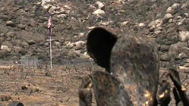 A flagpole sits near the area where 19 Prescott firefighters died June 30 fighting the Yarnell Hill Fire. (Source: CBS 5 News)