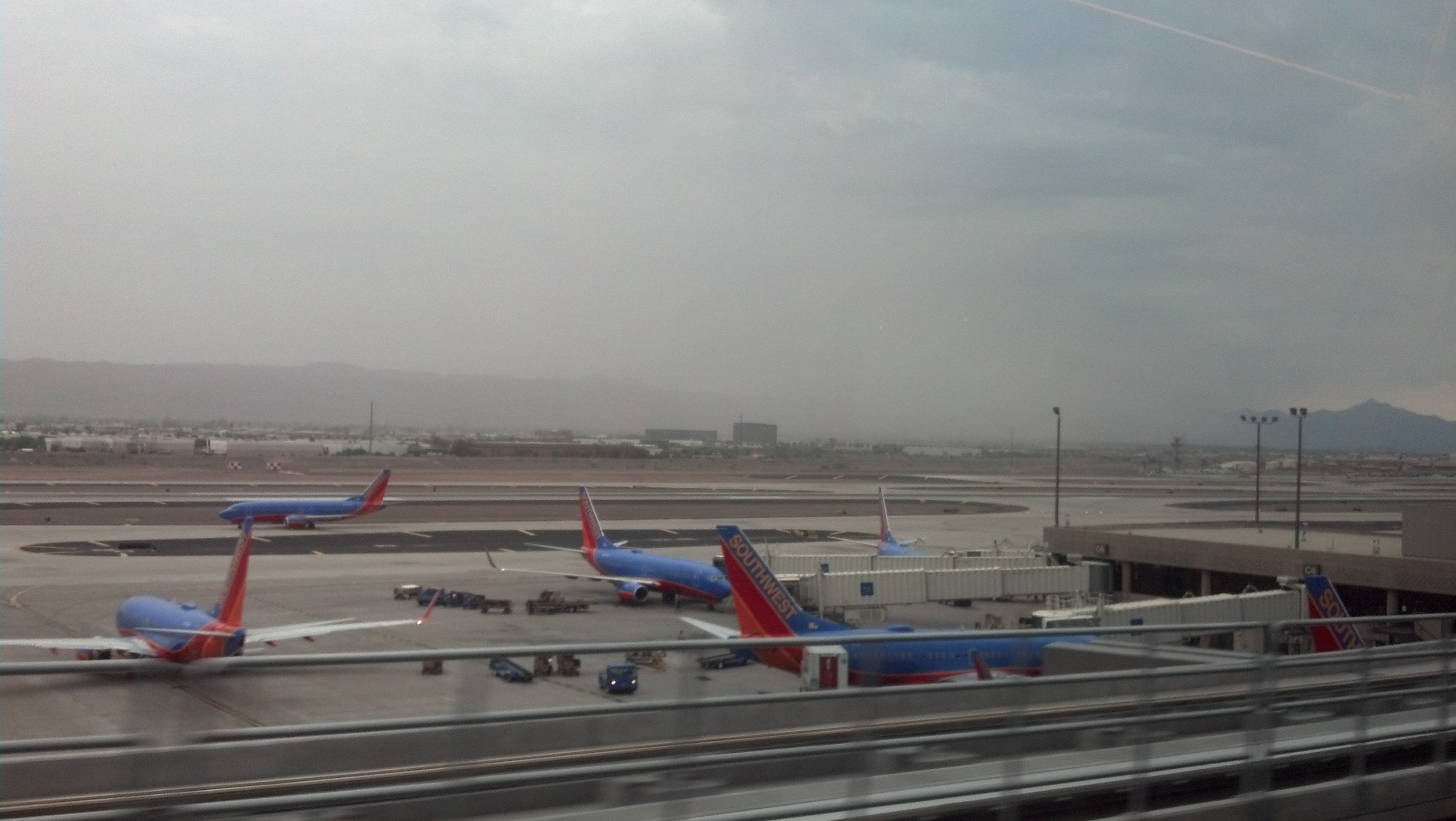 A dust wall coming over South Mountain from the Sky Train at Sky Harbor airport (Source: Sean Gates, CBS 5 News)