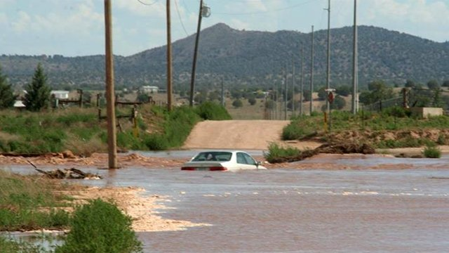 Flooding in Paulden. Car trapped in a wash at Feather Mountain Road. (Source: Mary Atonna)