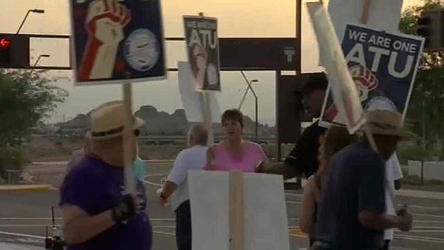 Striking bus drivers continue to picket Friday near Rio Salado Parkway and Priest Drive in Tempe. (Source: CBS 5 News)