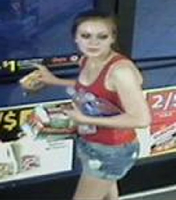 The female suspect had red hair at the time of the robbery. (Source: Peoria Police Department)