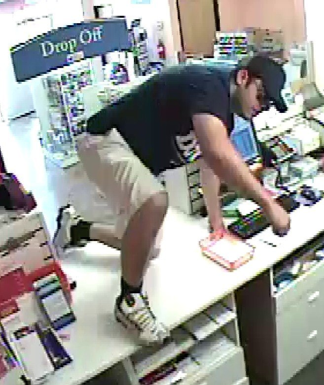 Surveillance photo of the suspect in the July robbery (Source: Silent Witness)