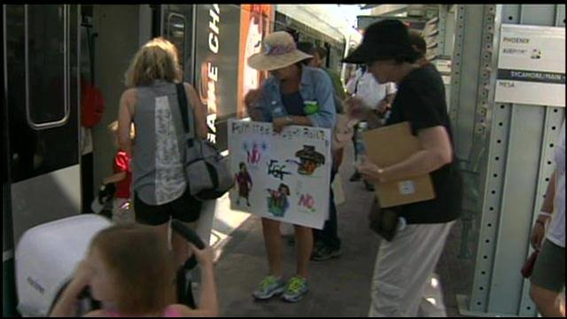 """Stroller Jam"" protests guns on the light rail. (Source: CBS 5 News)"