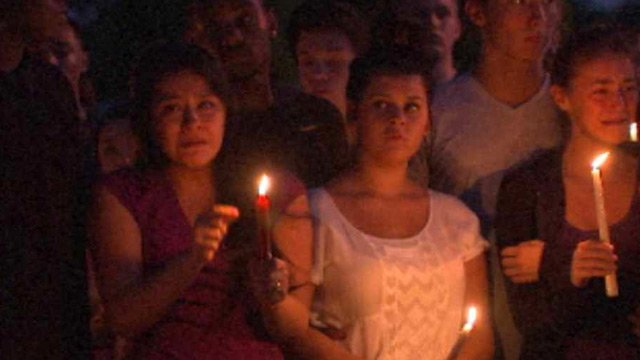 Friends and family of Julieann Arancel gather for an emotional prayer service Sunday evening. (Source: CBS 5 News)