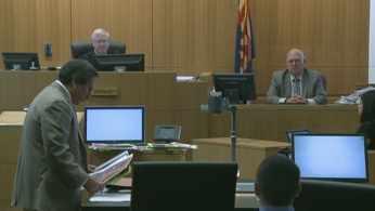 Prosecutor Juan Martinez guided Det. Ken Porter through the crime scene. (Source: CBS 5 News)