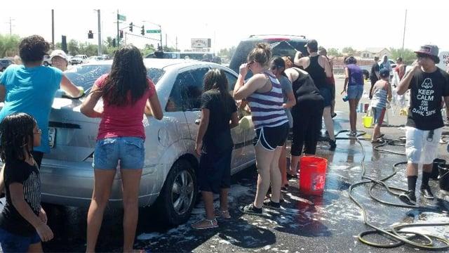 Benefit car wash held in Glendale for the slain officer. (Source: KPHO-TV)