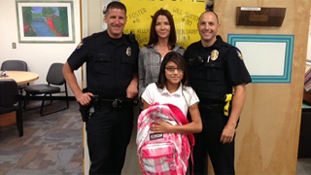 Leslie Gonzales poses with her new backpack. (Source: Phoenix Police Department)
