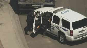 Man holds Surprise SWAT officers at bay. (Source: KPHO-TV)