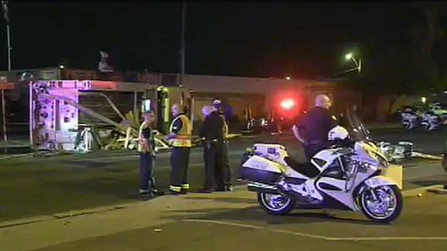 Phoenix firefighters and police officers look over the scene where the collision occurred. (Source: CBS 5 News)