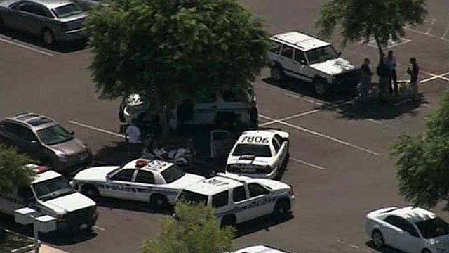 Chandler police units sit in a parking lot near a Walmart in Chandler that was evacuated after a bomb threat Friday. (Source: CBS 5 News)