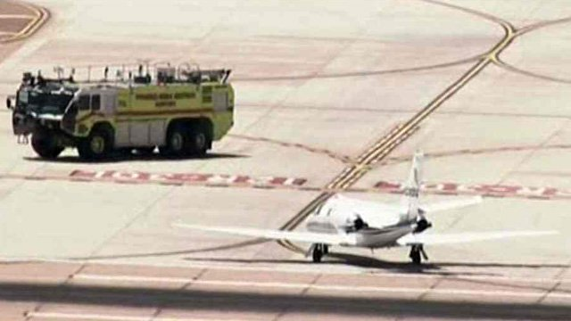 A fire truck was on standby when the plane landed at Phoenix-Mesa Gateway Airport just before noon. (Source: CBS 5 News)