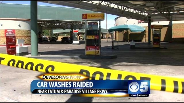 14 people were arrested and 30 others taken into custody in raids on Saturday at all 16 locations of Danny's Family Car Wash. (Source: CBS 5 News)