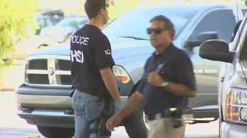 Homeland Security Investigations agents at the scene. (Source: CBS 5 News)