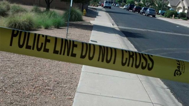 Police tape was still up Sunday morning at Betsy and Palm in Gilbert.(Source: Christina Batson, cbs5az.com)