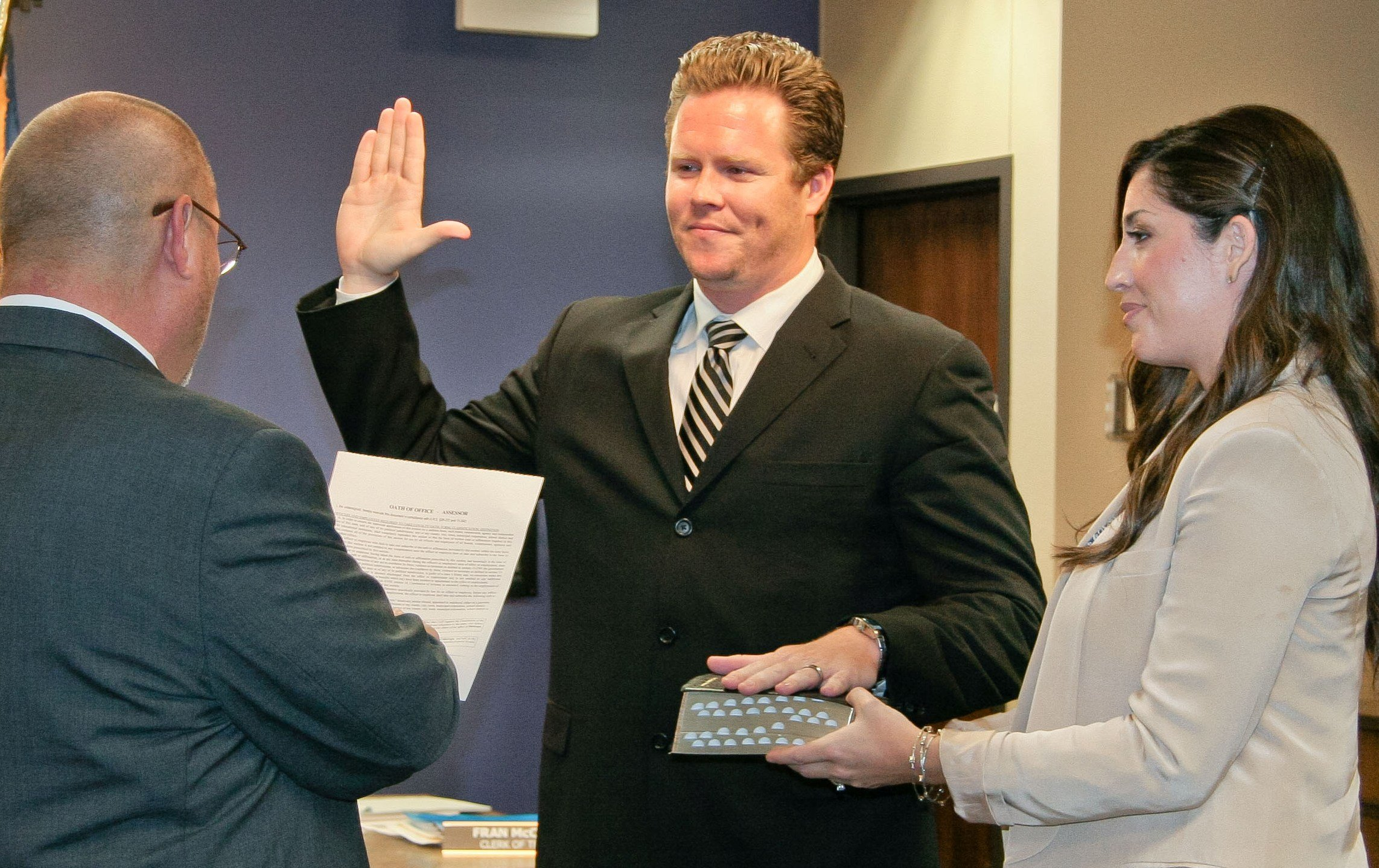 Former assessor and Justice of the Peace Keith Russell administering the Oath of Office on Aug. 19 to Paul Petersen. Also shown is Paul's wife, Raquel. (Source: Maricopa County Board of Supervisors)