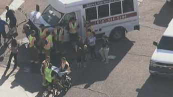 Car collides with small school bus in Goodyear. (Source: CBS 5 News)
