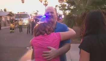 The homeowner, who everyone thought was dead in the fire, is warmly embraced. (Source: CBS 5 News)