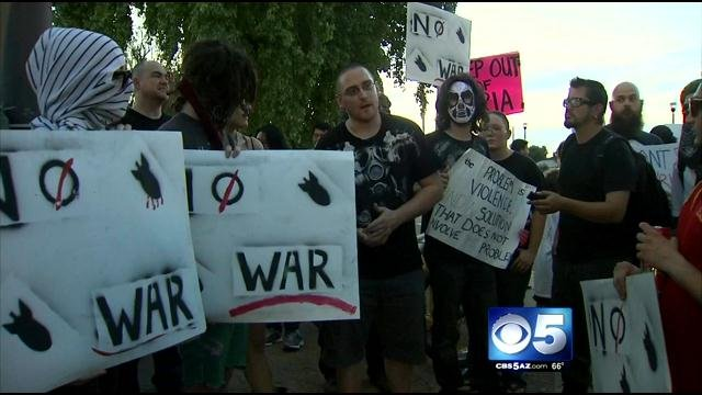 Syrian protests at Mill and University avenues Saturday night in Tempe. (Source: CBS 5 News)