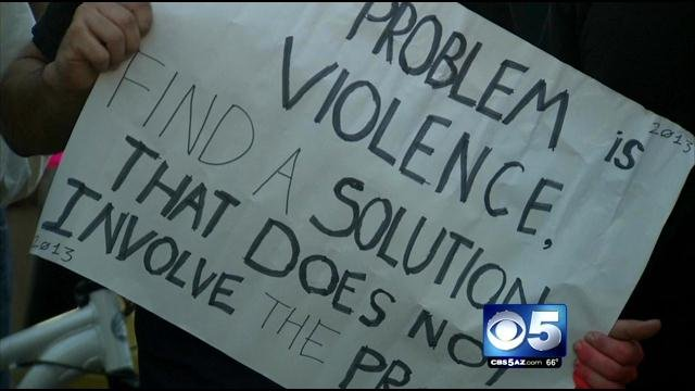 Several protesters call on Congress to reject a pending strike against Syria. (Source: CBS 5 News)