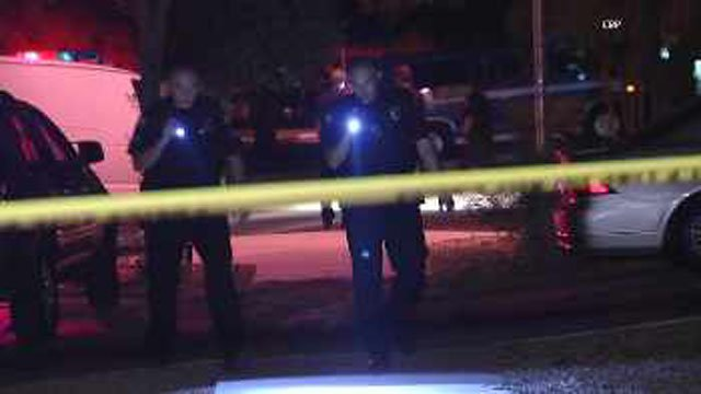 Phoenix police scour the area of the shooting for clues. (Source: CBS 5 News)