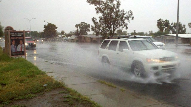 An SUV plows through water after a storm dropped rain at 48th Street near Baseline Road. (Viewer-submitted photo by Steve Aron)