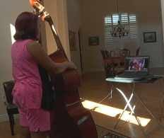 Kaylin Womack, 10, takes bass lessons over Skype. (Source: CBS 5 News)